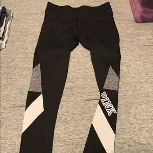 Black, white, and gray PINK workout pants